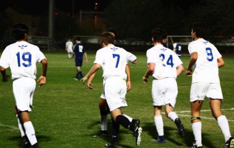 Varsity boys celebrate after F.Schwenger(#7) scores a penalty