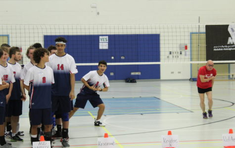 Excited for the first serve of the new season, ASD's boys' varsity volleyball team represented school pride in brand-new uniforms.