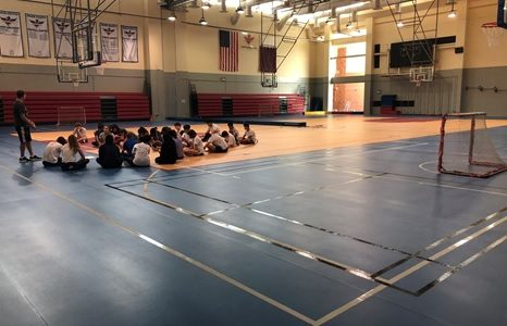 By Sept. 24, the HS gym floors were ready for use. Above, a 10th grade P.E. class gets an introduction to their new unit from Mr. Trevor Dufresne.