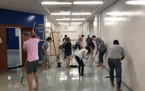 Musical cast cleans up flood water while singing after show cancellation