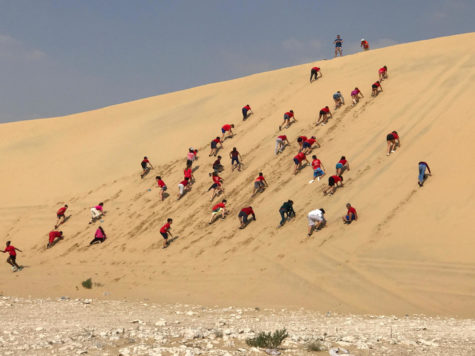A 6th grade group raced each other up the sand dunes during one of their Week Without Walls activities.
