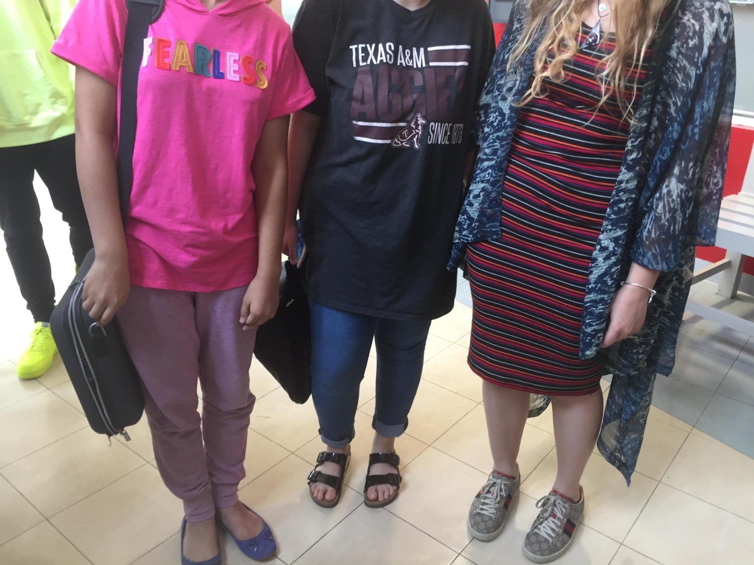 Three ASD HS students wear dress-code-approved clothing.