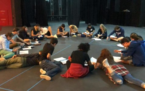 The musical cast completes their first group read-through of the script.