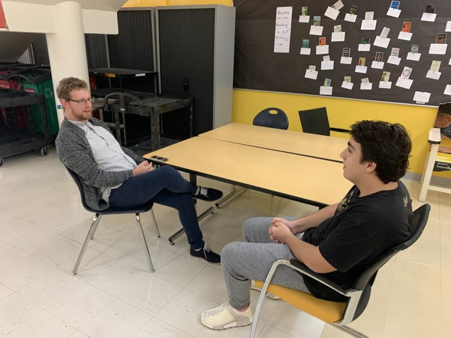 Math teacher Mr. Garret Robbins has a wide range of interests and talents. He's open to speaking with students about his background, as he did here with ASD Times reporter Cem D.