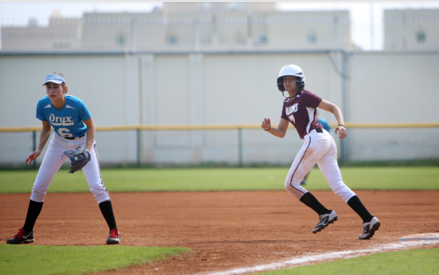 ASD team softball players, infielder S. Bulteel ('21) and base runner M. Nivarthi ('20), prepared for their school season by participating in a four-team league as part of QLL last year.  Photo compliments of QLL Facebook page.