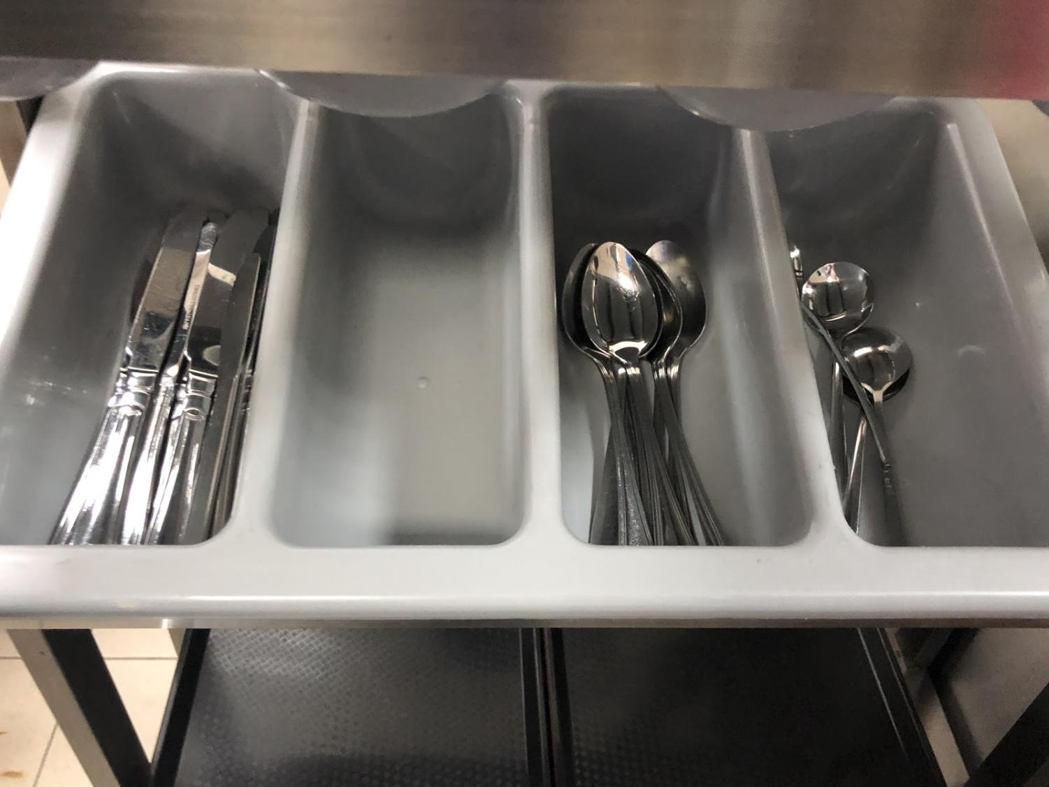 This photo of a cafeteria utensil bin was taken three minutes after the start of the HS lunch period.