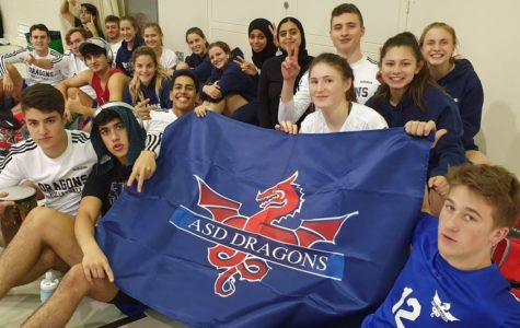 The boys' and girls' varsity Dragon teams supported each other throughout the season. They cheered each other on in Filipino league play in Doha, and they traveled together to Muscat to raise each other's spirits.