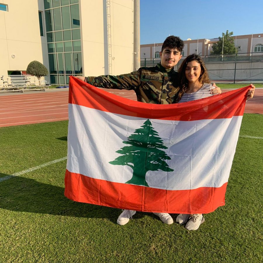 H.+Rakab+%28%2720%29+and+R.+Azrieh+holding+the+Lebanese+flag+after+the+opening+ceremony+of+International+Week.+++++++++Photo+taken+by%3A+Z.+Al-Fardan