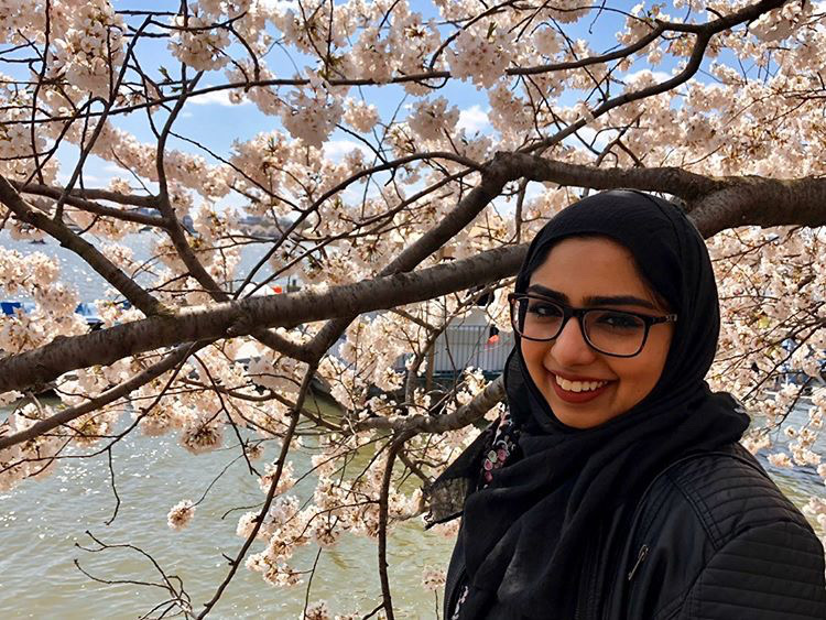 Leila Waraich exictedly poses at the Cherry Blossom Festival in D.C.