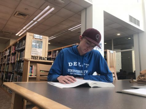 W. Bridge ('21) prepares for the upcoming SAT by seeking our resources in the ASD library.