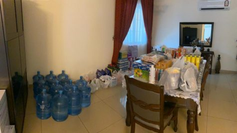 A snapshot of Rami Fakih's home dining room, filled with groceries to last him and his roommate months.